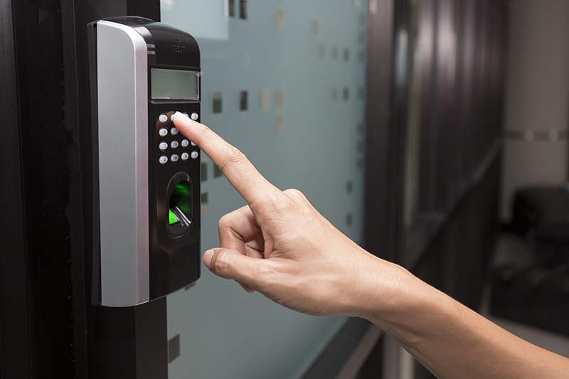 Person Using Biometric Access Control Keypad